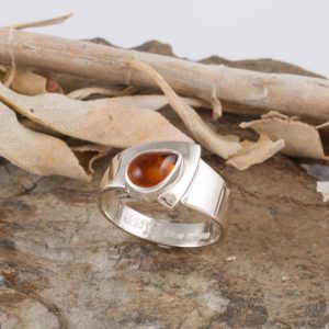 Amber sterling silver ring, blue turtles