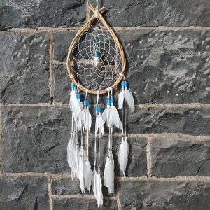 rattan oval with traditonal web and blue and silver bead dream catcher